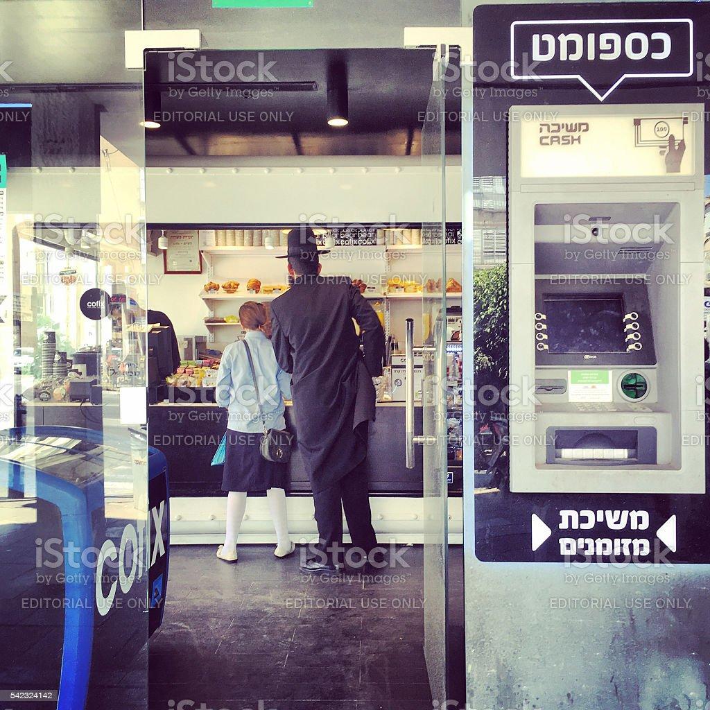 People buying food in bakery, Bnei Brak, Israel stock photo