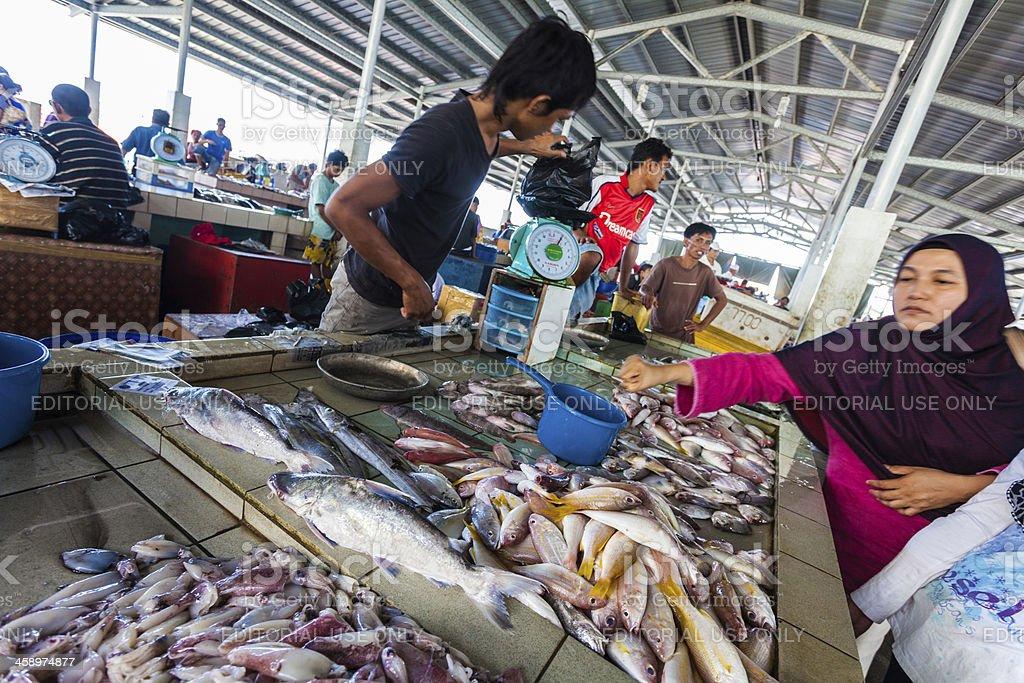 People Buying Fresh Fish at the Market, Malaysia royalty-free stock photo