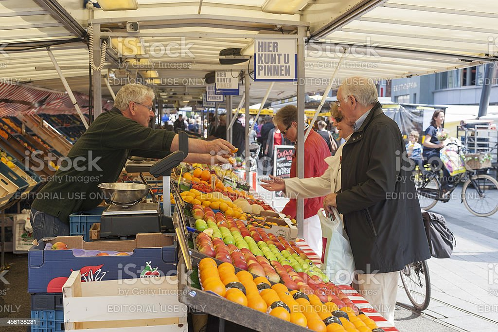 People buying fruit on the market in Enschede stock photo