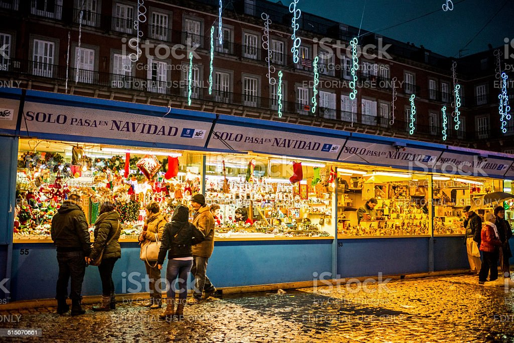 People buying gifts at Christmas Market, Madrid stock photo