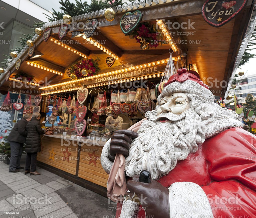 people buying gingerbread cookie heart on Christmas Market stock photo