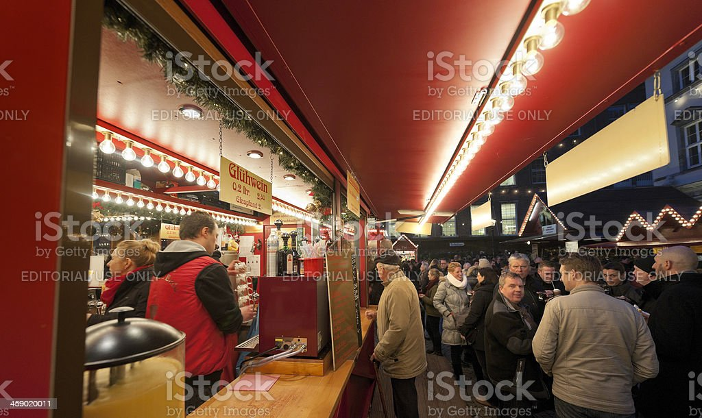 people buying mulled wine at Christmas Market in Dusseldorf Germany royalty-free stock photo