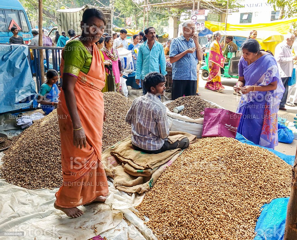 People buying peanuts at fair, Bangalore, India stock photo