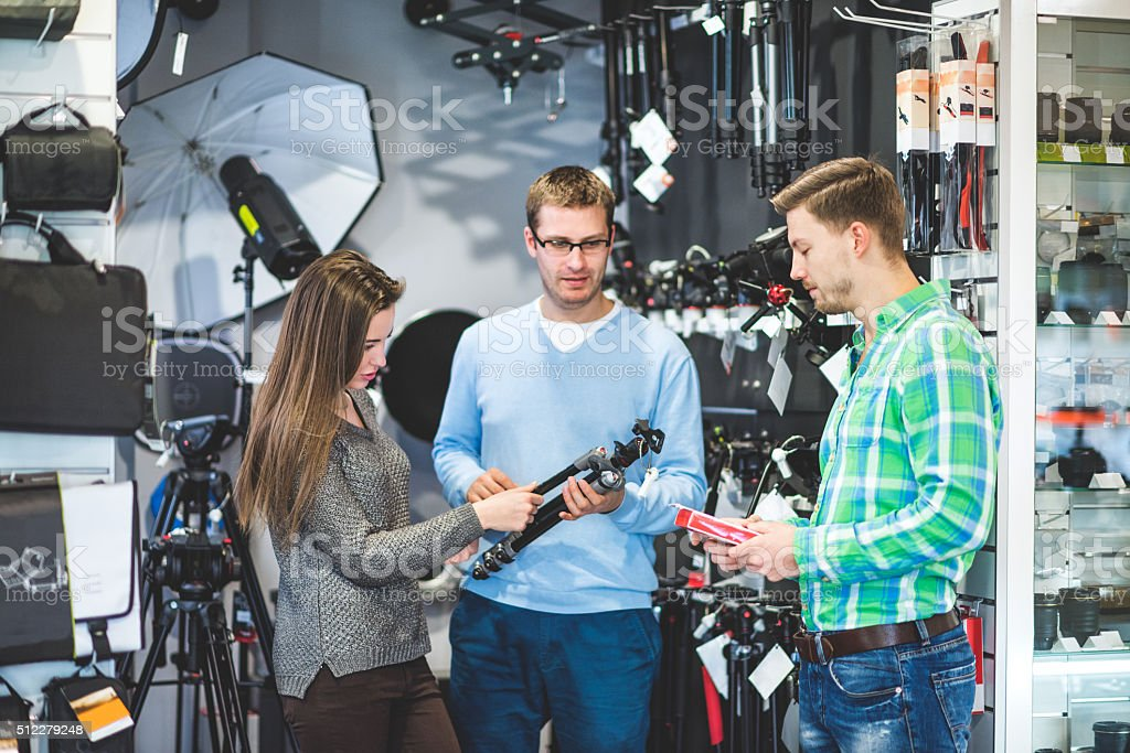 People buying photographic equipment stock photo