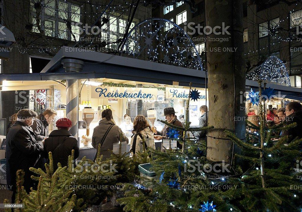 people buying Reibekuchen at Christmas Market in Dusseldorf Germany stock photo