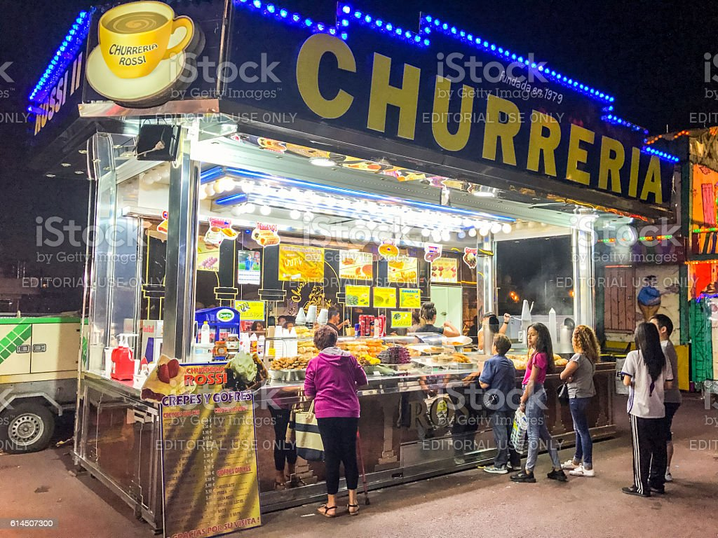 People buying snack in Barcelona amusement park, Spain stock photo