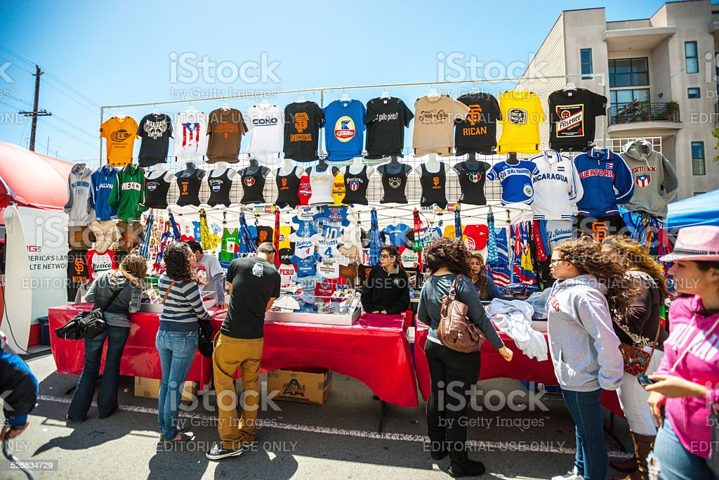 People buying t-shirts during Carnaval Festival stock photo