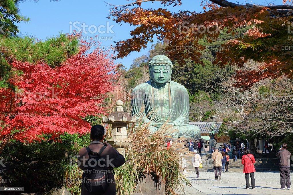 People came to pray the bronze statue of Amitabha Buddha. stock photo
