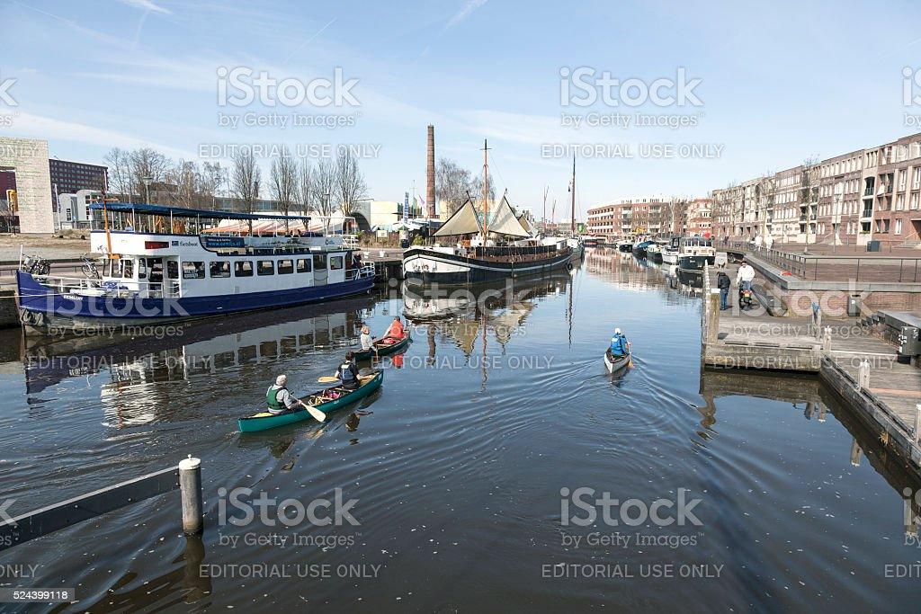 people canoe on river Eem in dutch city Amersf stock photo