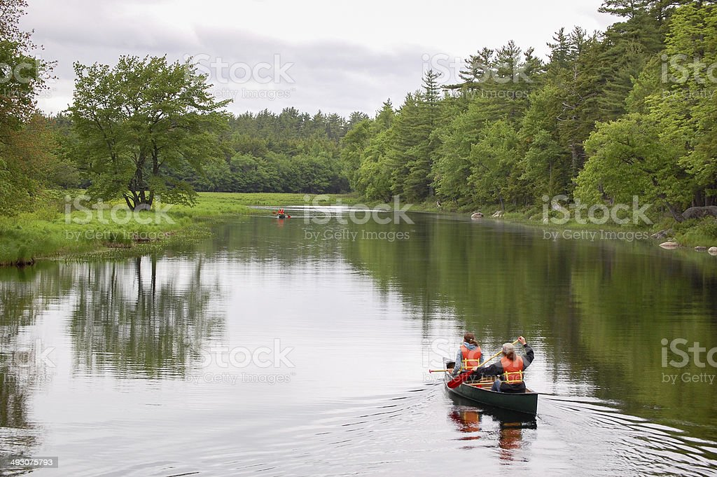 People Canoeing in a Park stock photo