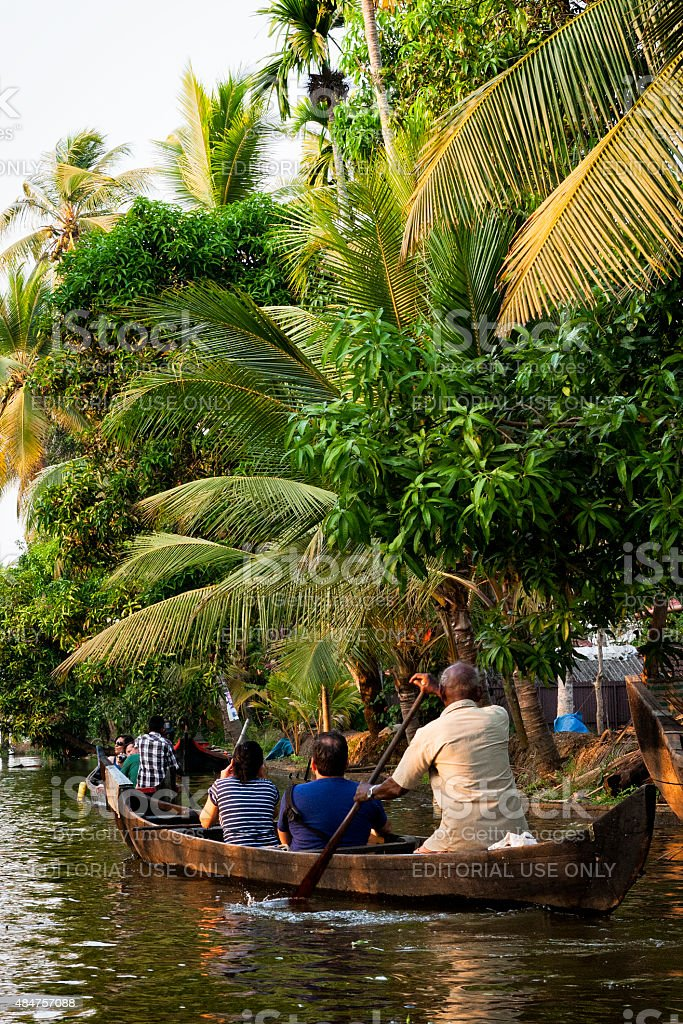 People canoeing on the Kerala Backwaters in India stock photo