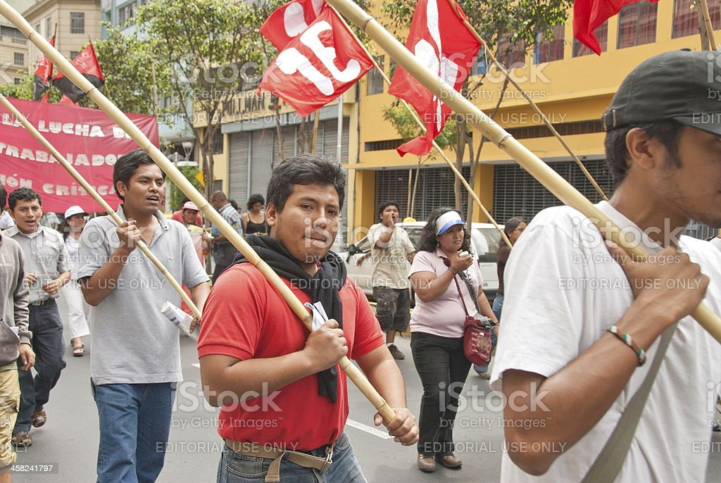 People carry flags at May Day demonstration in Lima, Peru. stock photo