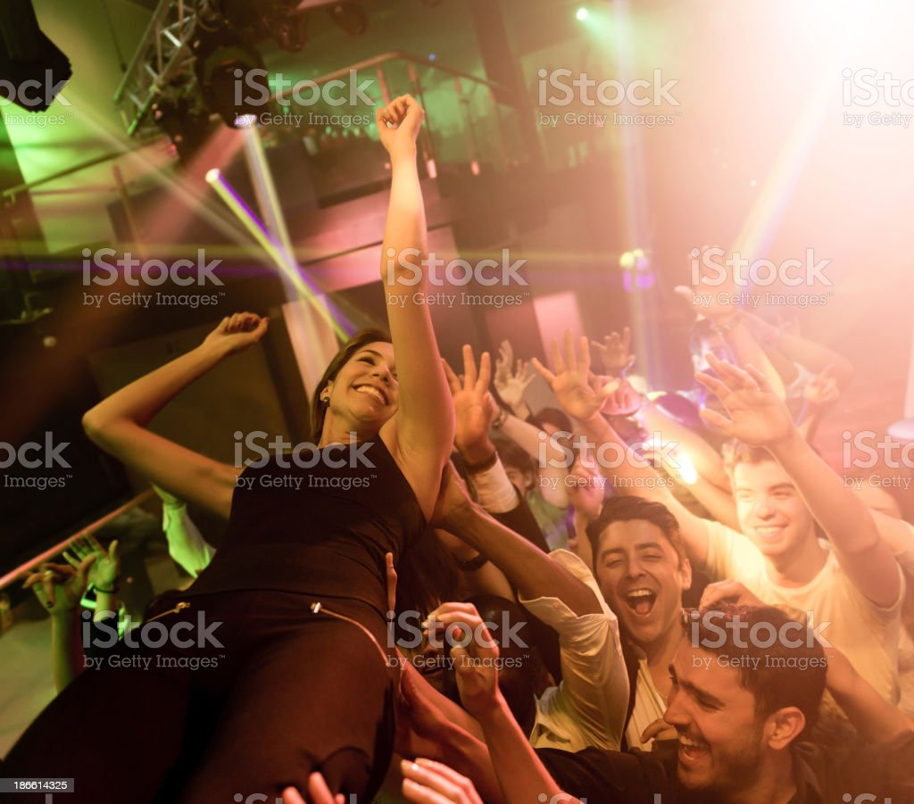 People carrying a woman at the concert royalty-free stock photo
