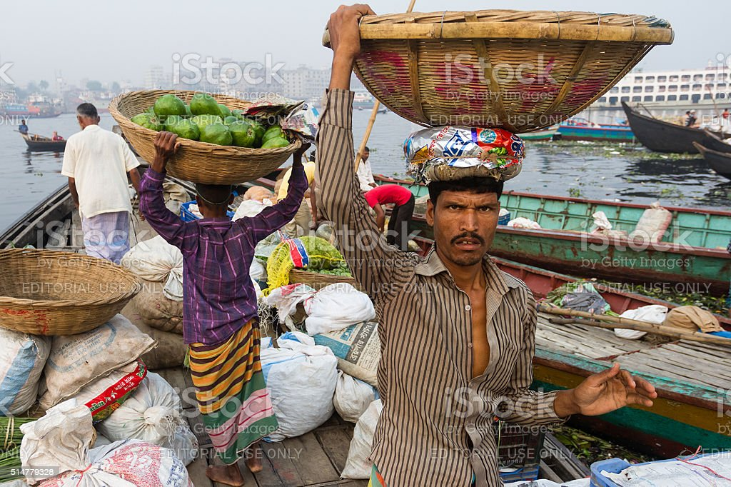 People Carrying Vegetable From the Boat stock photo