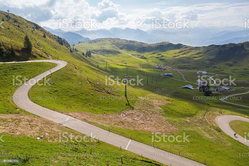 People, cars on windy Panoramastrasse scenic road in Kitzbuhel, Austria stock photo