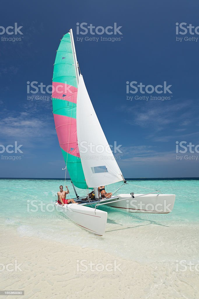 people catamaran beach stock photo