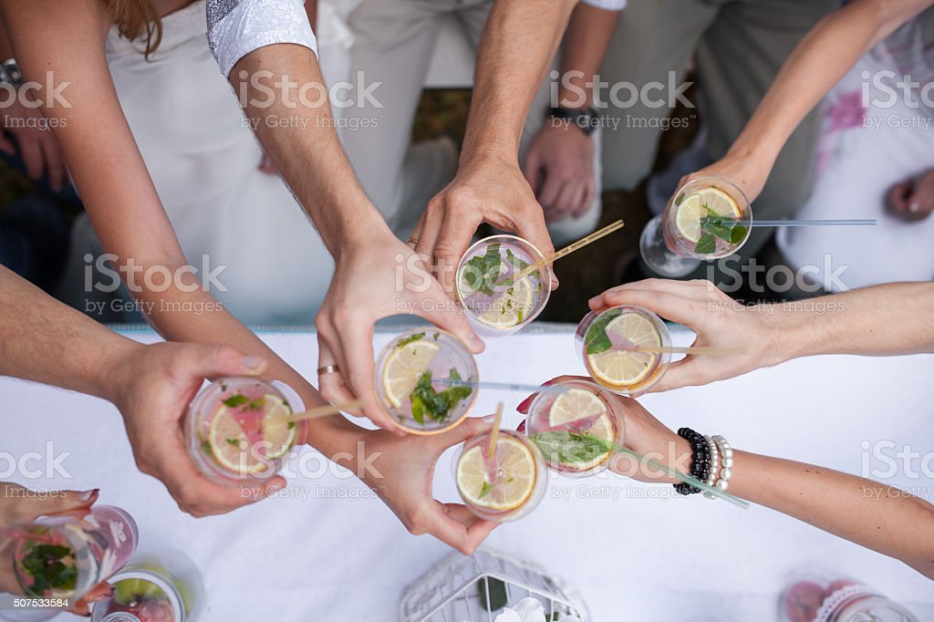 people celebrate. Clink glasses with the drink stock photo