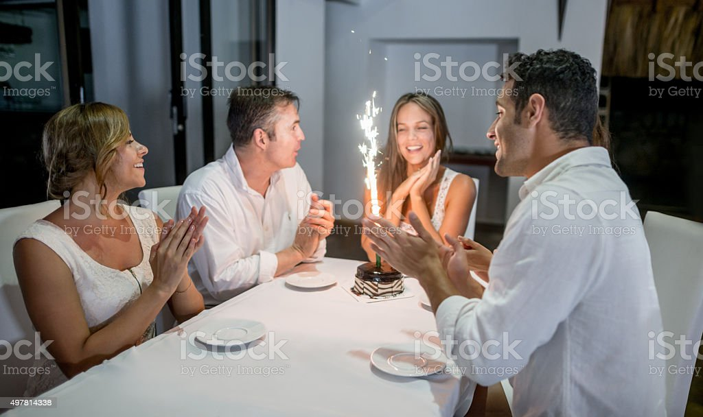 People celebrating a birthday stock photo