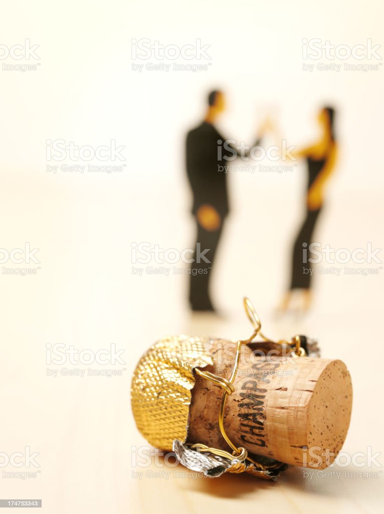 People Celebrating and a Champagne Cork royalty-free stock photo