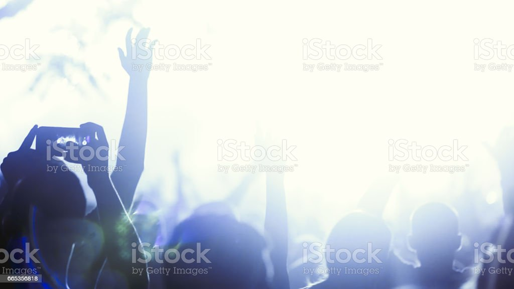 People celebrating and dancing in festival stock photo