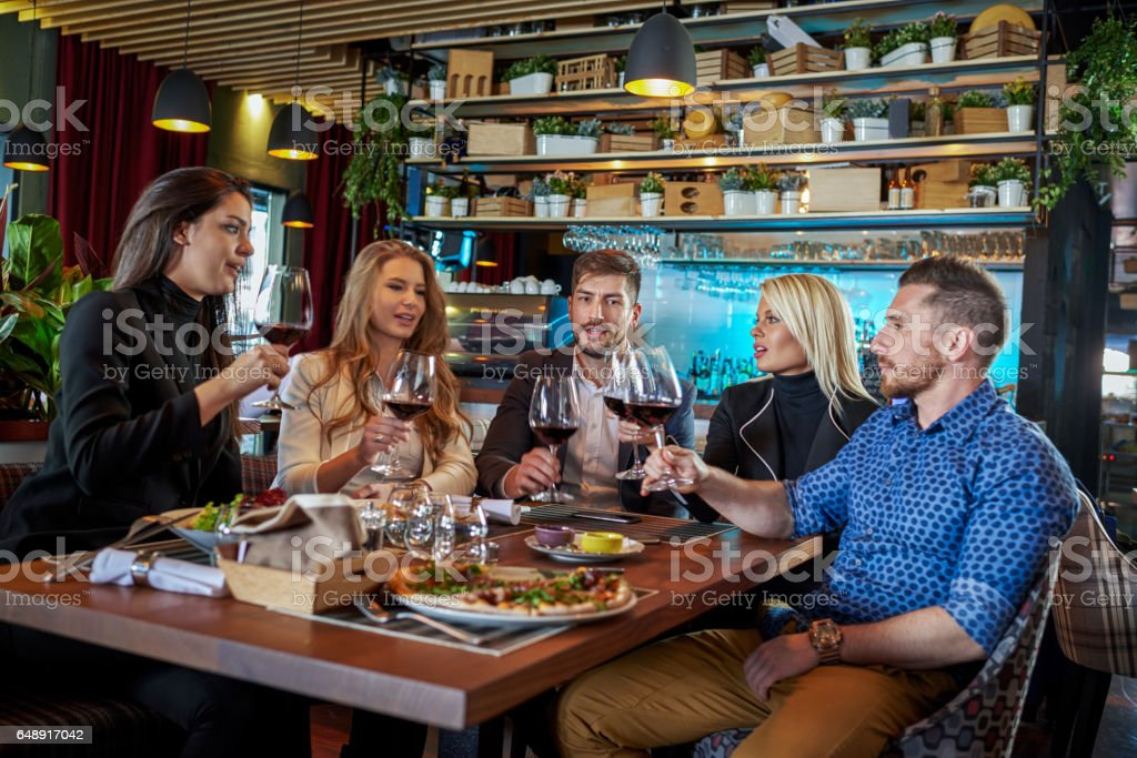 People celebrating in the restaurant stock photo