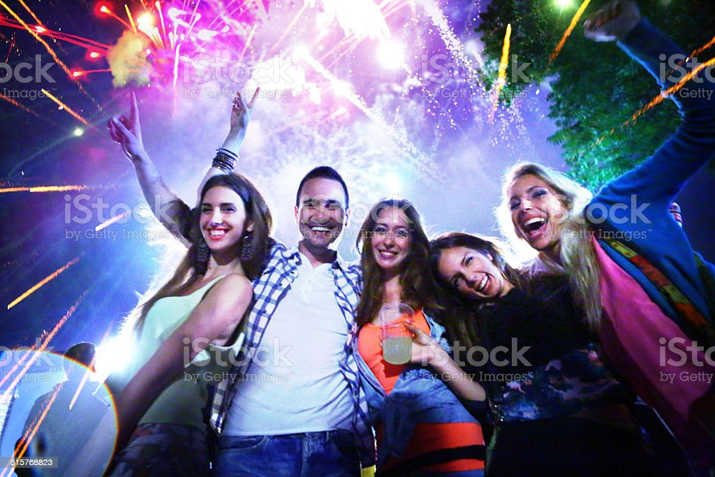 People celebrating with fireworks. stock photo