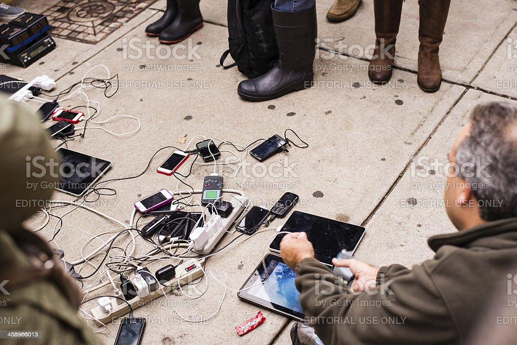 People charging mobile devices after hurricane Sandy stock photo