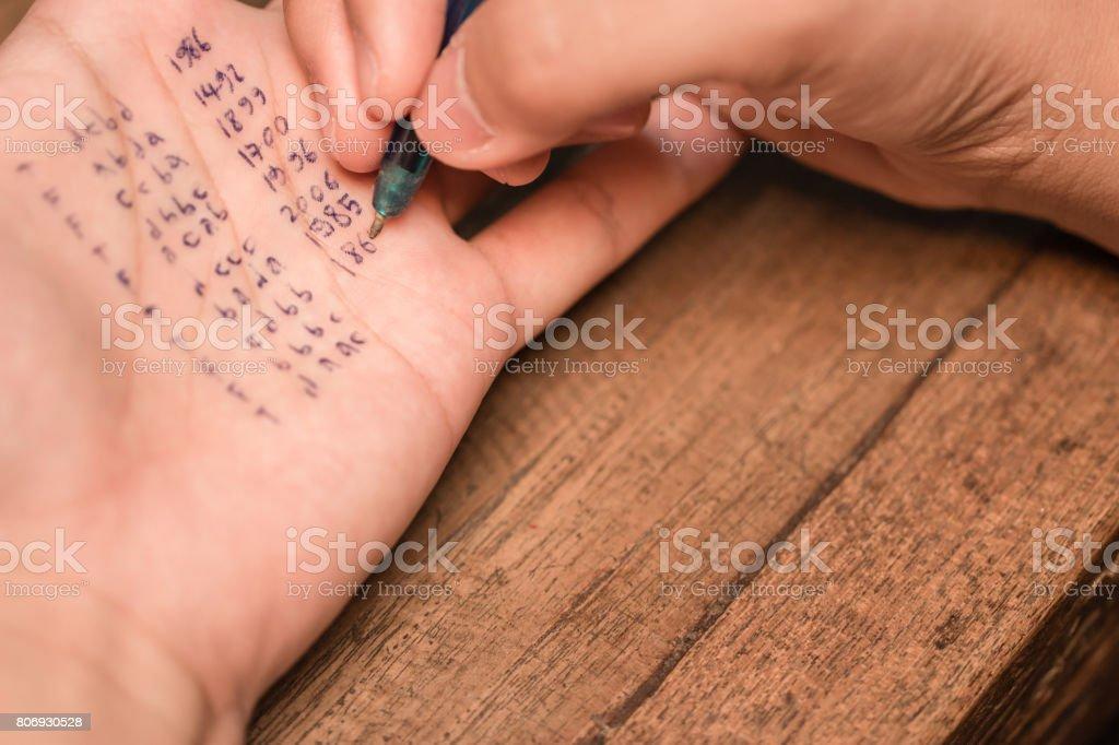 People cheating on exam stock photo