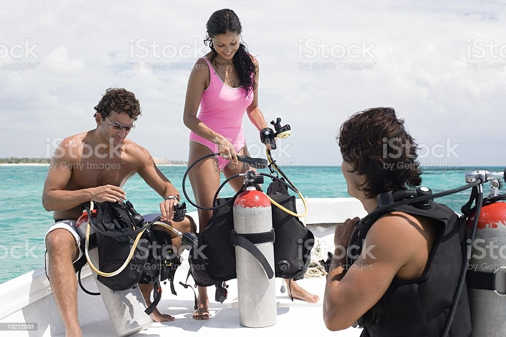 People checking diving equipment stock photo