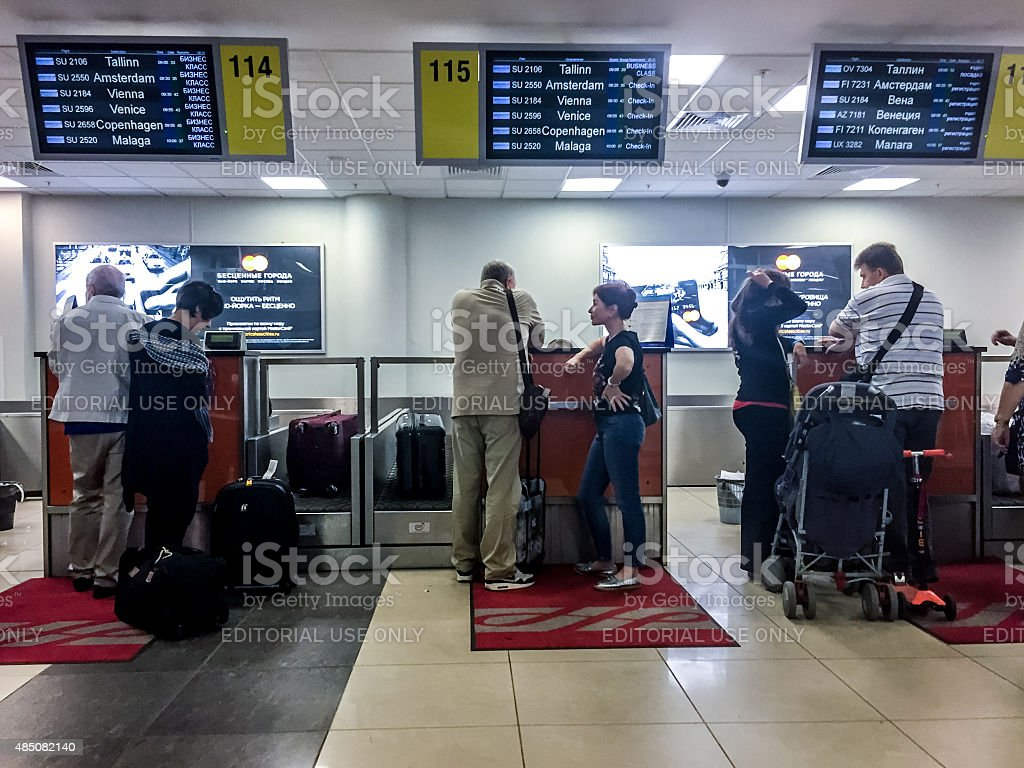 People checking in on their flight, Sheremetyevo Airport, Moscow stock photo