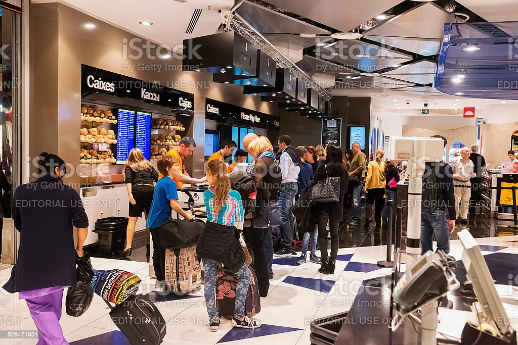 People Checking Out at Barcelona Duty Free Store stock photo