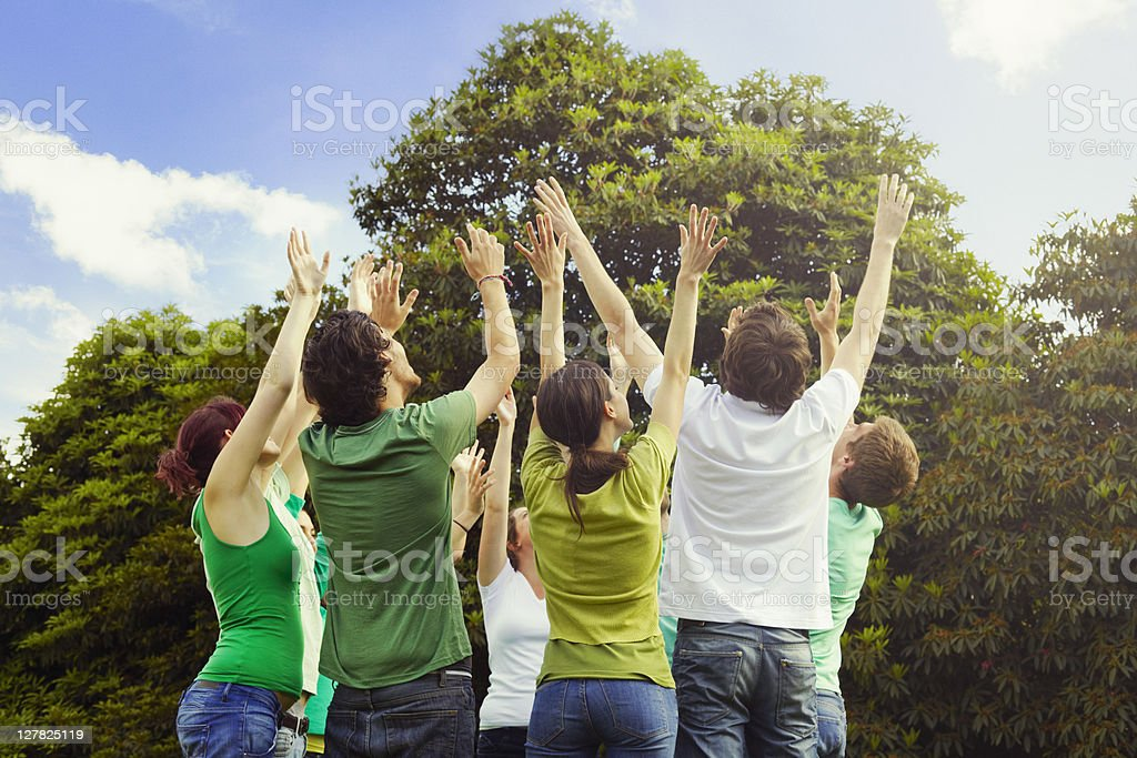 People cheering outdoors royalty-free stock photo