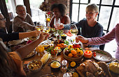 People Cheers Celebrating Thanksgiving Holiday Concept