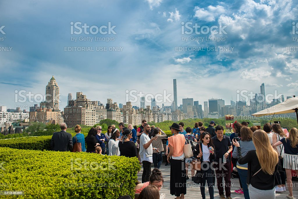 People chilling on rooftop with Manhattan and Central Park view stock photo