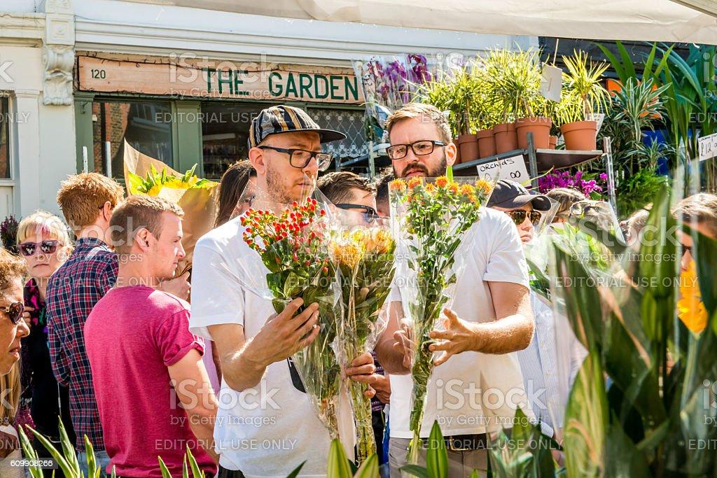 People choosing flowers stock photo