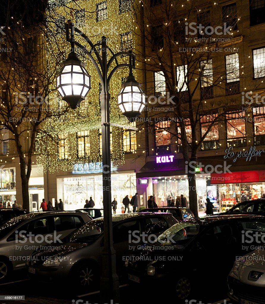 people Christmas shopping in Dusseldorf Germany at night stock photo