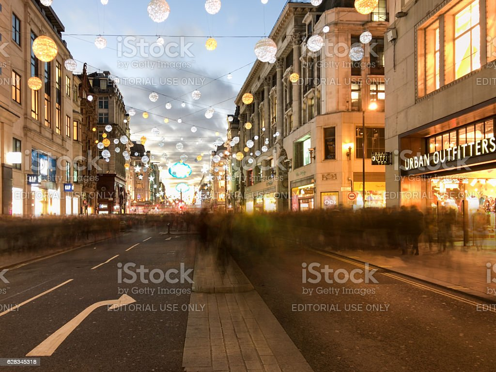 People Christmas shopping with motion blur on Oxford Street stock photo