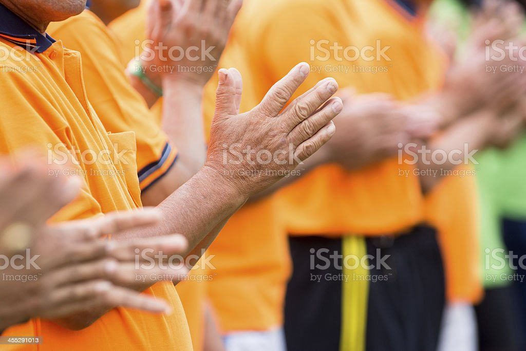 people clapping stock photo