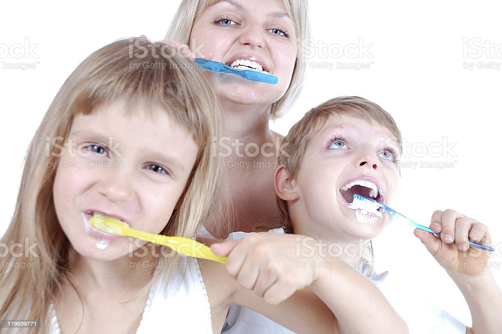 people cleaning teeth stock photo