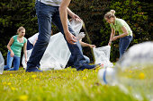 People cleaning up litter on grass