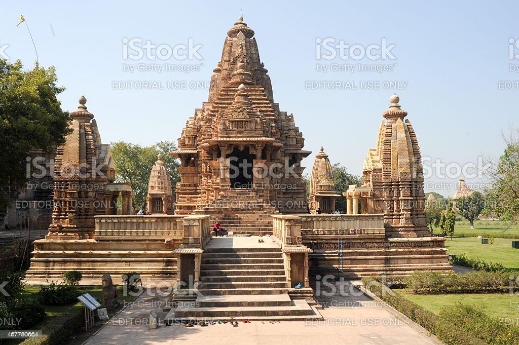 People climb to the hindu temple of Khaiuraho on India stock photo