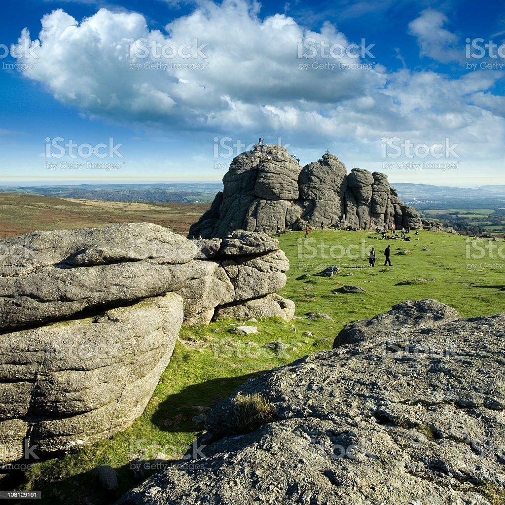 People Climbing Haytor Rocks in England stock photo