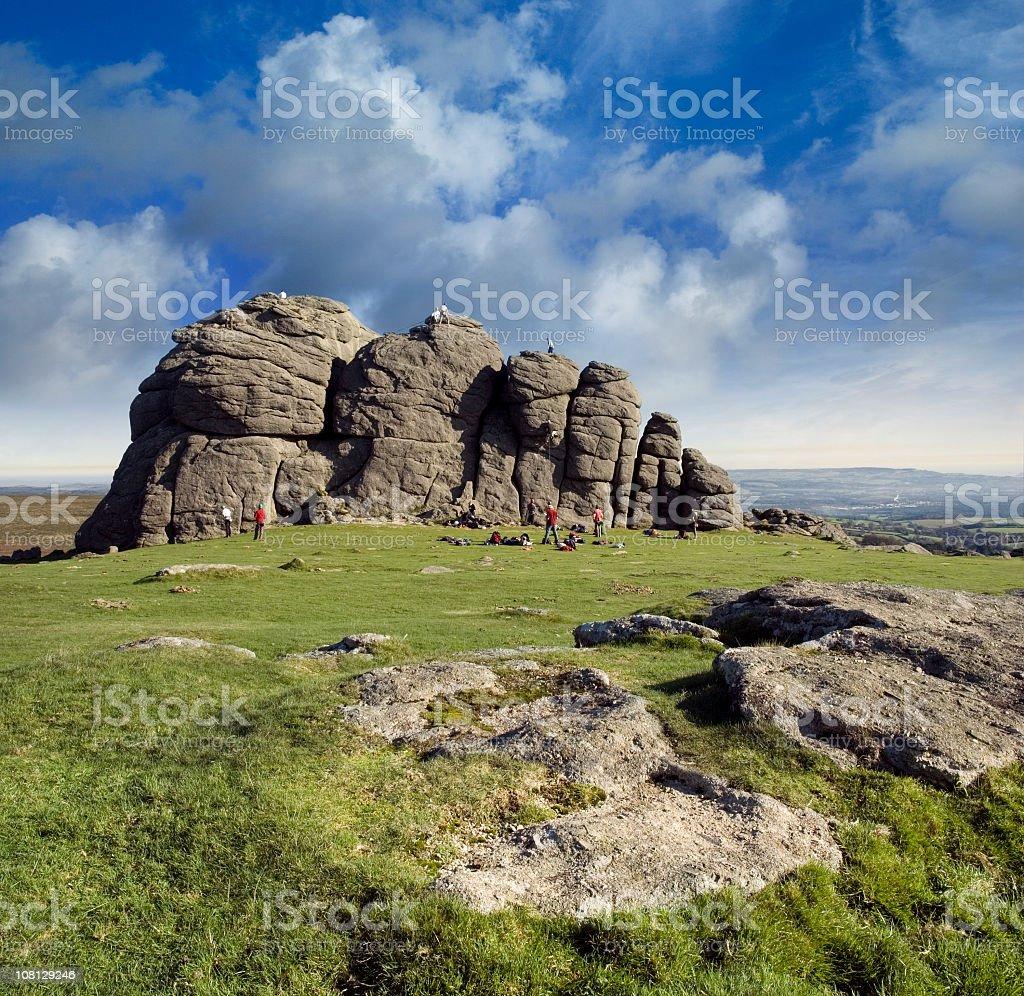 People Climbing Haytor Rocks in England royalty-free stock photo