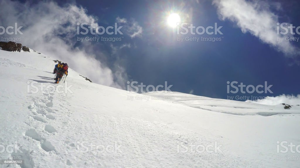 People Climbing Mont Blanc in Alps, France stock photo