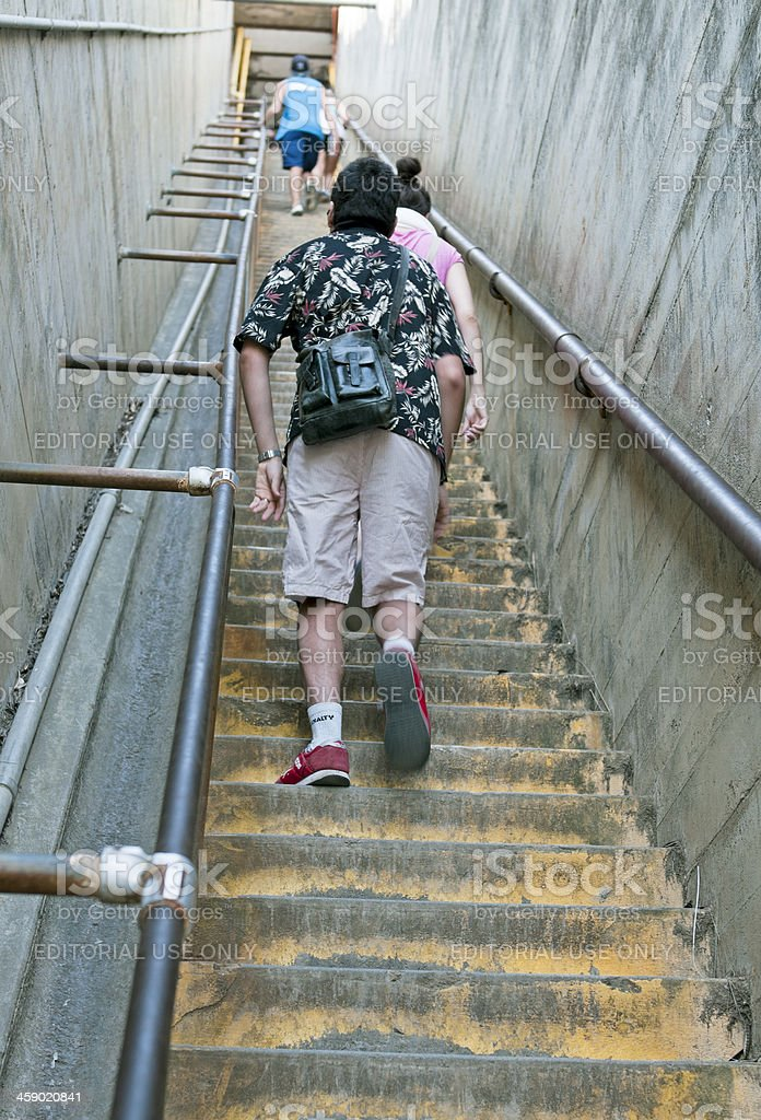People climbing stairs to view point on Diamond Head Crater royalty-free stock photo