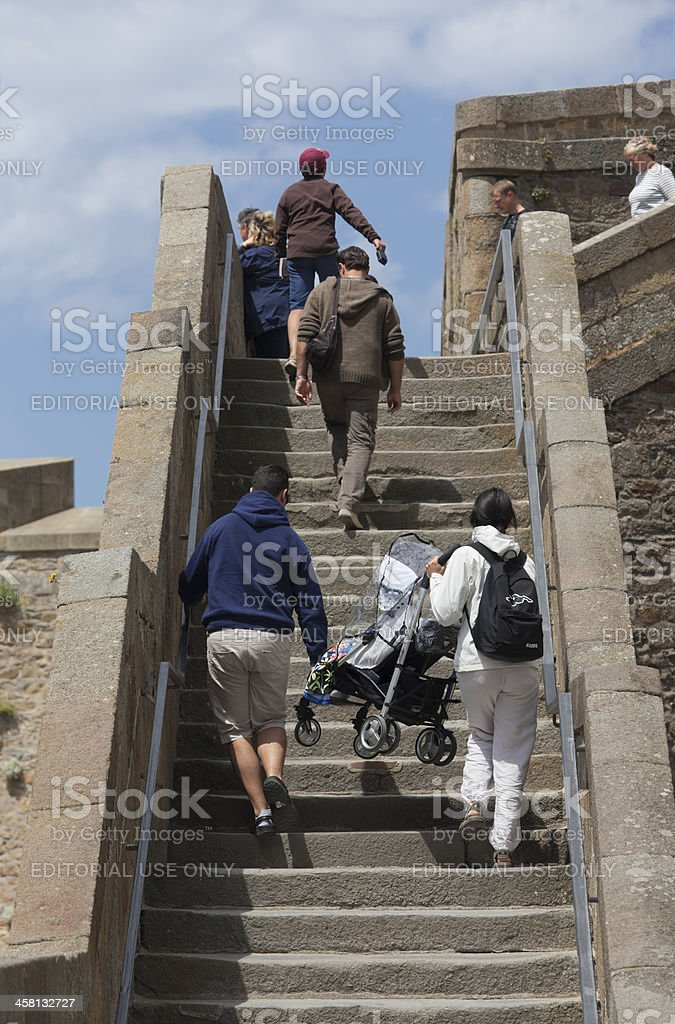 People climbing steps in old town of Saint-Malo, France royalty-free stock photo