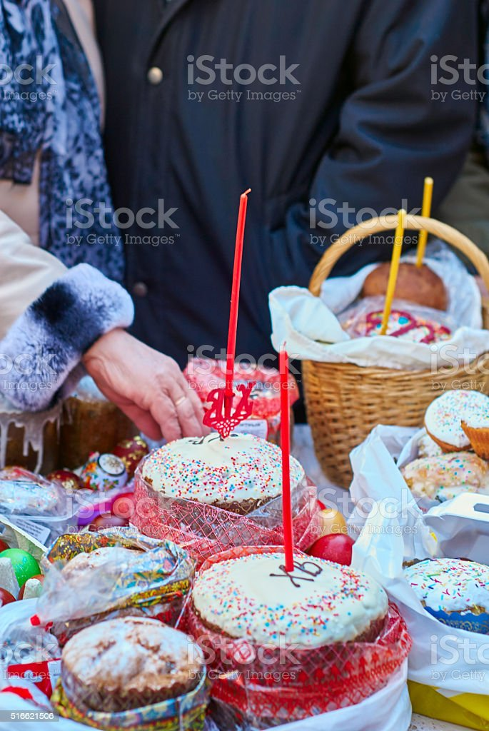 People come to church consecrate Easter cakes and eggs stock photo