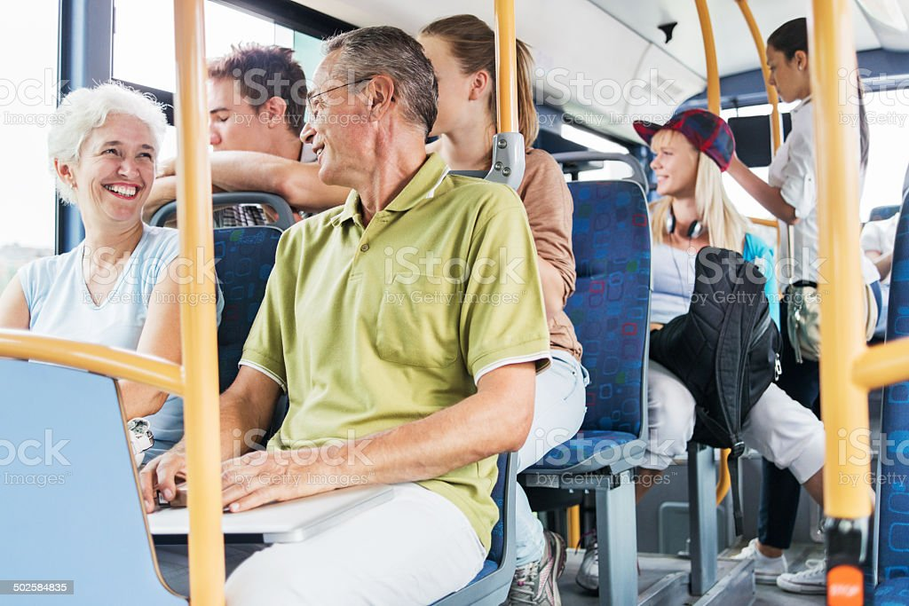 People communicating while travelling by bus. stock photo