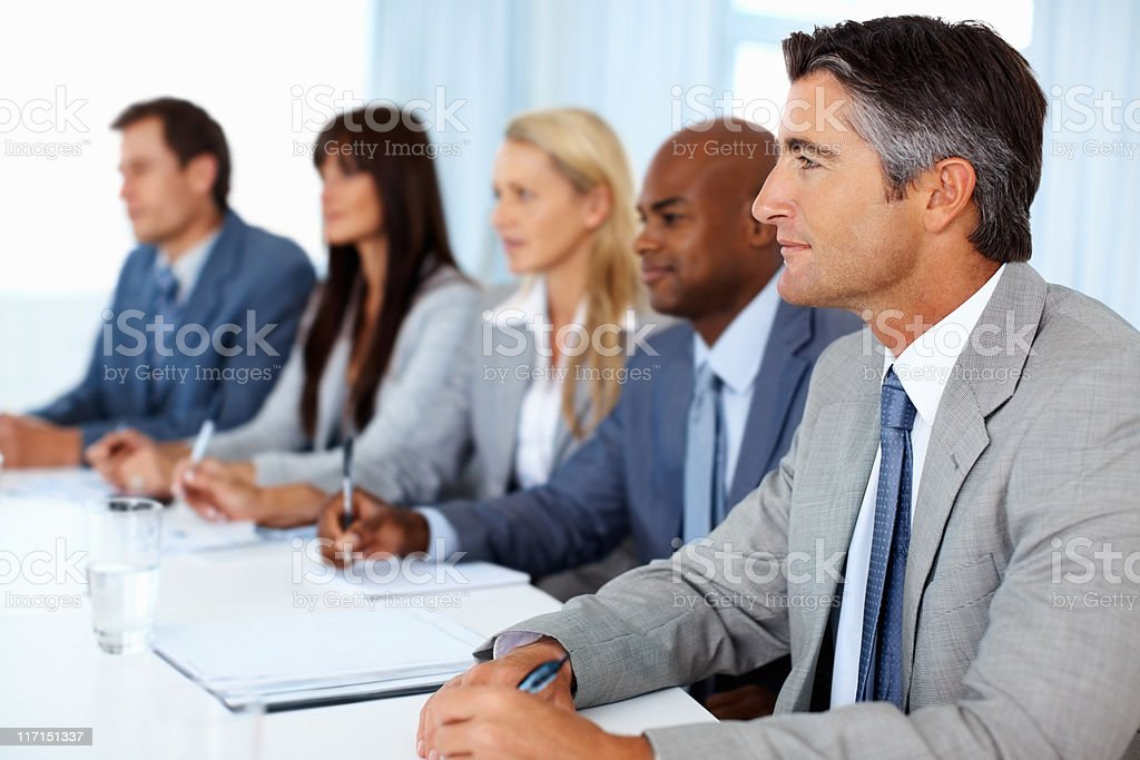 People concentrating at business presentation royalty-free stock photo