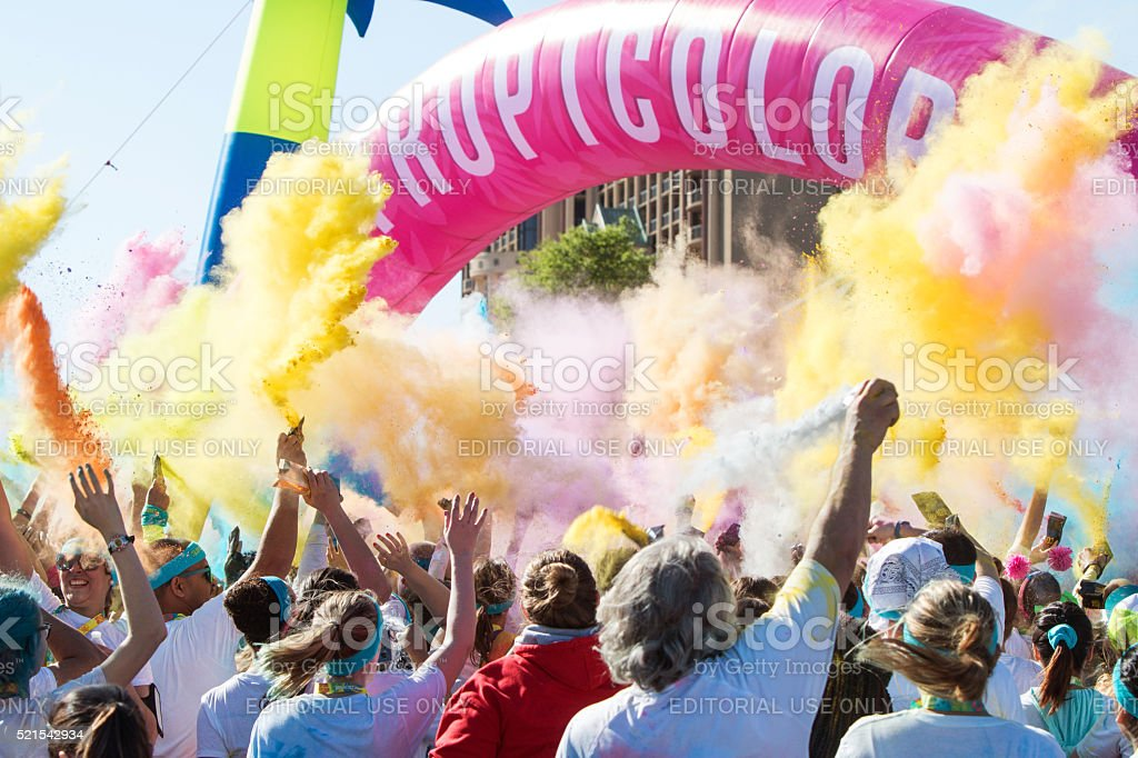 People Create Color Explosion With Multicolored Corn Starch Packs stock photo